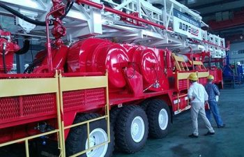 USR Drilling engineers inspecting the 14 wheeler truck with a drilling rig.