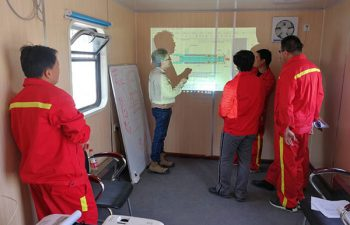 USR Drilling engineer training Chinese workers on new solutions.